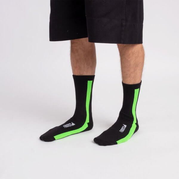 calza-nera-linea-verda-fluo